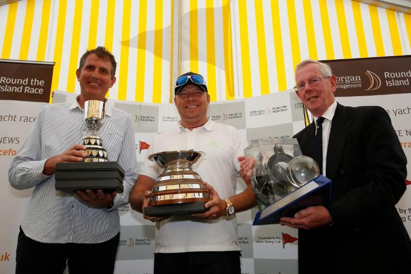 Lloyd Thornburg (centre) and his co-helm Brian Thompson (left) are pictured with Rear Commodore Peter Bingham and their fantastic collection of trophies after their stunning & record-breaking Race on Phaedo^3. Image: Patrick Eden.