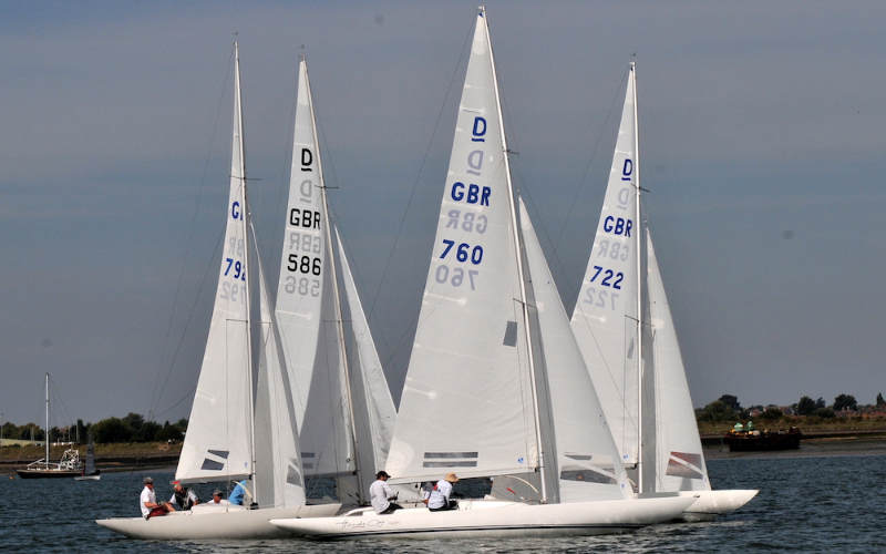 Glorious Fools crossing the Town Cup finish line at the Royal Corinthan Yacht Club – photo Sue Pelling