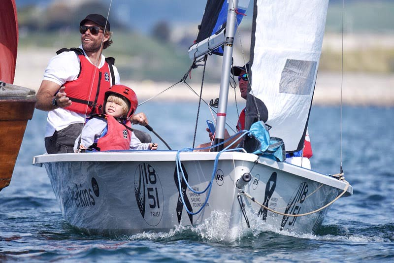 Local sailing clubs join thousands on the water to remember Olympic sailor