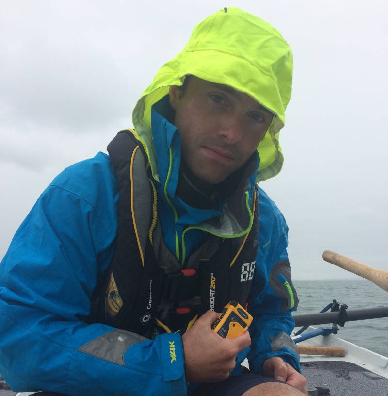 Carbon Zerow rower Kyle Smith with one of the Ocean Signal rescueME PLB1s
